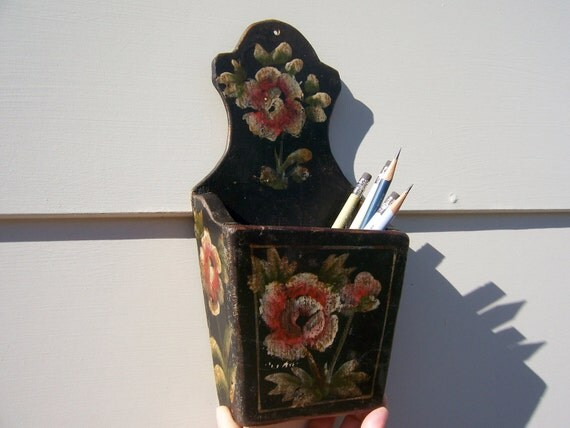 Wall pocket vintage box made of wood. Hand painted black with floral design in red, cream, gold and green.