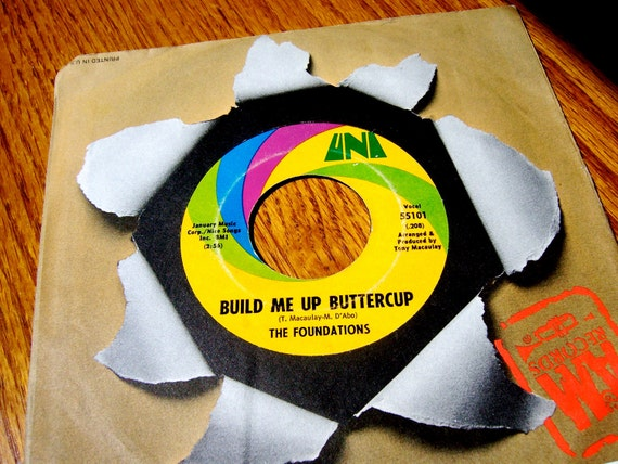 Vinyl 45 record in paper sleeve. Build Me Up Buttercup/New Direction by The Foundations. For retro pop rock fan, home decor or art supply.