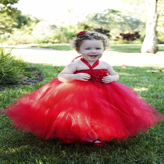 Classy red tutu dress available in red and gold. Available sizes newborn to 24 months.