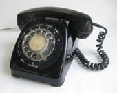 Black telephone - rotary style made in Canada- works- ring sound like in MAD MEN