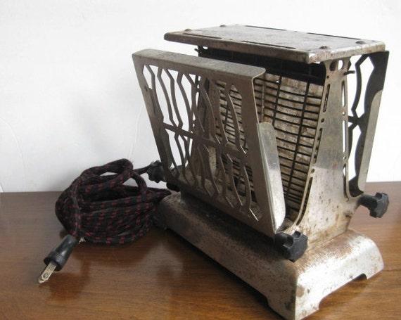 Antique Flip side toaster- works 110V 55amps made in Canada