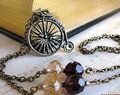 Penny Farthing Bicycle Necklace Antique Bronze with Faceted Amethyst and Champagne Crystals