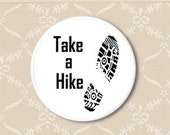 Shoe print hike. Pinback button