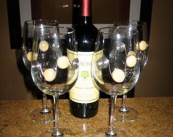 Set of 4 embellished wine glasses.