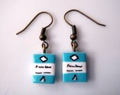 Penguin Book Dangle Earrings in Blue by Coryographies