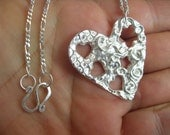 Love Me Do... Unique  Handmade Fine silver textured and cut away heart with sterling silver chain and hammered clasp