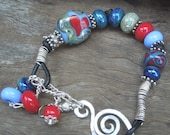 Lampwork bead bracelet with sterling silver and greek leather. Handmade in Australia SRA