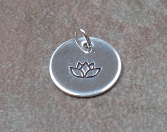 Silver stamped charm, lotus, one additional charm