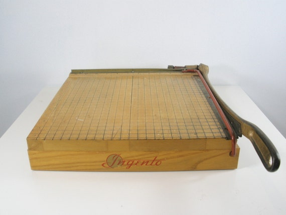 ingento paper cutter The ingento guillotine style paper cutter is constructed with a solid maple base to deliver dependable and long lasting trimmer performance this model is perfect for shared workspaces with high volume project, photo and paper trimming needs.