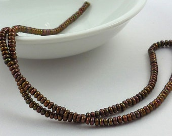 Tiny eggplant/ bronze center drilled button pearls 3mm x 2mm 1/2 strand