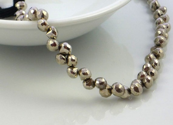Awsome silver coated pyrite faceted onion briolette beads 4- 5mm set of 10