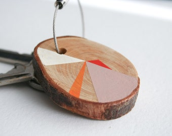 Pine wood keychain with stainless cable wire option plus initial on other side, pink, red, orange, white geometric triangle shapes keyring