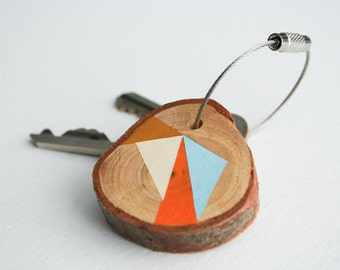 wood keychain with stainless steel cable wire with option of custom initial with orange, blue, and dark yellow geometric triangle keyring