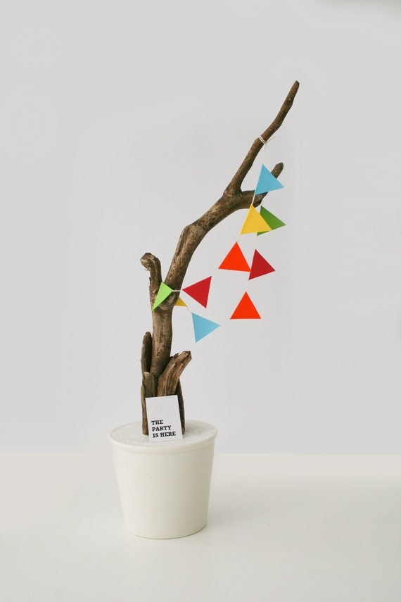 The party is here home decoration sculpture with natural wood and colourfull garland