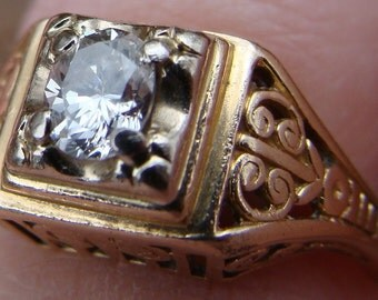 Vintage Heirloom setting 14K ring with .25 caret perfect Diamond