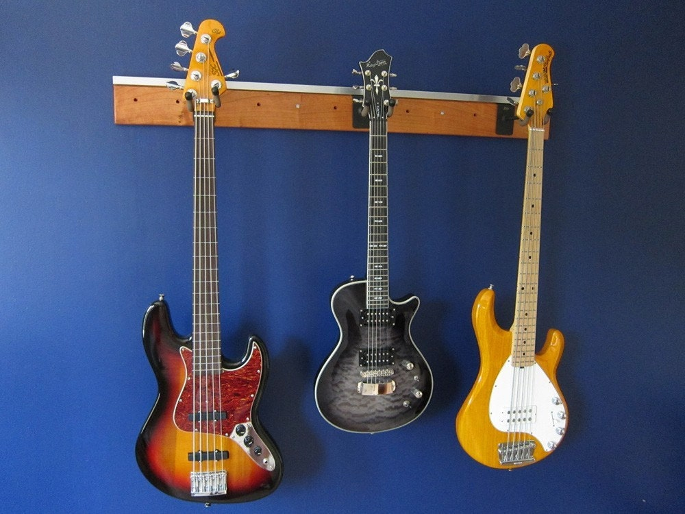 Light Your Guitar Wall Mount : Is it better to hang your guitar from a wall mount, or to let it sit on a stand ...