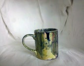 Tradtional Coffee  Mug with Blue, Yellow, Slightly Green, and a Hint of Red