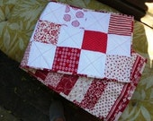 Crisp red and white squares table runner