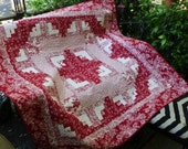 Red and white log cabin quilt