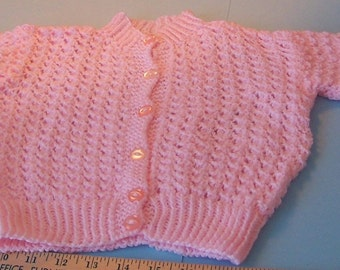 pink baby's sweater