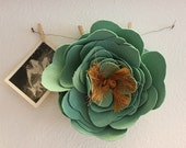 Worn turquoise fabric flower hair comb