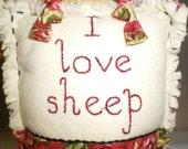 Appliqued Sheep door hanger on floral print fabric