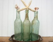Beach Cottage - Antique Ship's Bottle Collection and Seashell Stoppers In Vintage Silver Tray