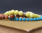 Multi Strand Stack Bracelet - Peridot Jasper, Turquoise, & Wood with Silver Spacers and Flower Stamped Cubes - by We Are 1