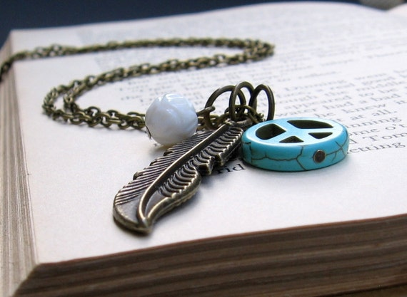 Turquoise Howlite Peace Sign, White Carved Shell, Brass Feather & Chain - NECKLACE