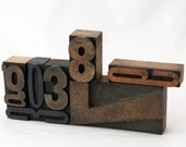 Seven letterpress letters and numbers