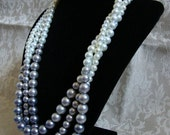 Blue fade pearls - three stranded necklace