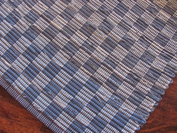 Handwoven checkerboard rug from recycled blue jeans