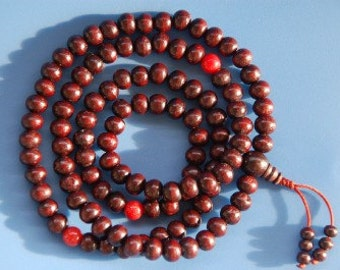 Dark rosewood mala with coral spacer beads