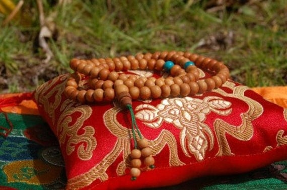 Sandalwood mala with turquoise spacers for meditation