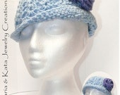 Blue w/ purple flower that is attached- all handmade