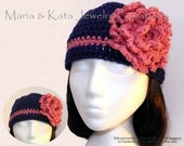 Crochet hat with color trim and big crochet flower