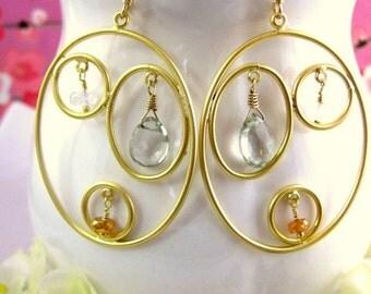 Gold triple hoop oval earrings with green amethyst