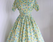 1950's Green printed Day Dress with Nipped waist  and Sash
