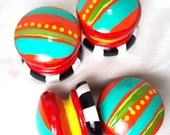 4 Knobs in turquoise, red, orange, and yellow with black and white