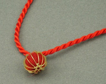 Red and Gold aromatherapy necklace
