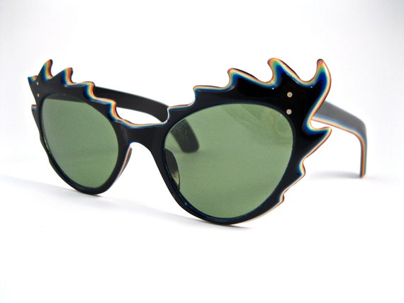 RESERVED-------       rainbow spiked cat eye sunglasses. super unique and awesome. made in france. non prescription.