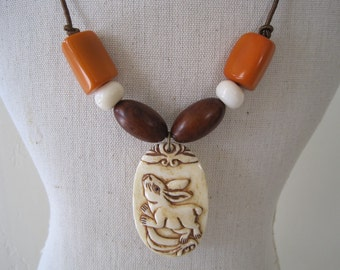 Carved Rabbit and Tagua Seed Necklace