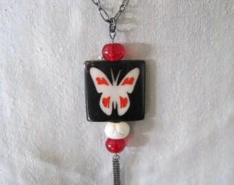 Gunmetal Horn Butterfly Tassel Necklace