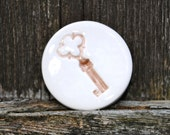 ceramic Key Brooch Round badge with a Key Imprint in sepia brown