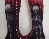 Fetal skeleton dripping blood one of a kind converse boots.