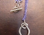 Blue & Sterling Silver Love Knot Pendant Necklace