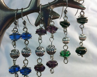 Dangle earrings in silver with purple, green, or blue glass beads