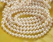 1/2 strand  5-6mm white roundish potato freshwater pearls