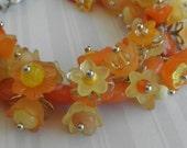 Yellow orange flower charm bracelet
