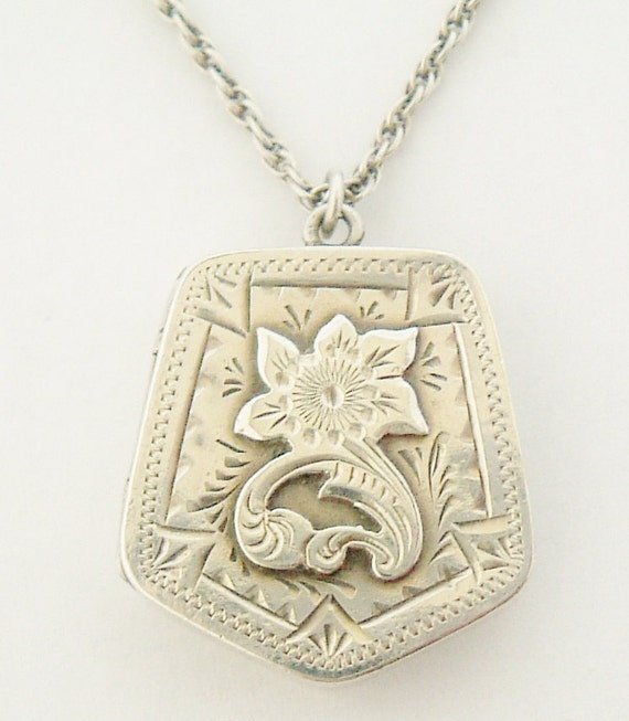 Victorian sterling silver locket and chain on 18 inch sterling chain.Hallmarked Birmingham 1900.